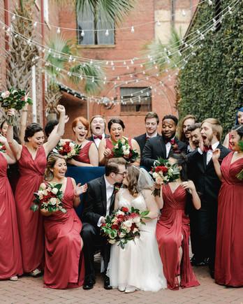 elizabeth seth wedding couple kissing surrounded by wedding party