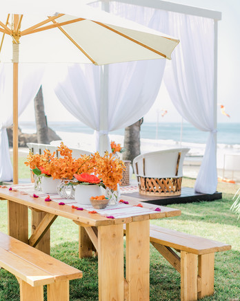 wooden tables with vibrant orange floral decor