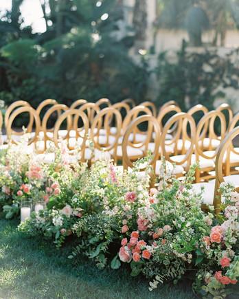 lush floral arrangements lining ceremony aisle