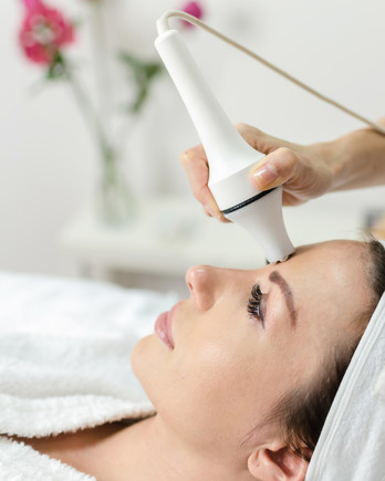 woman getting facial laser skin treatment