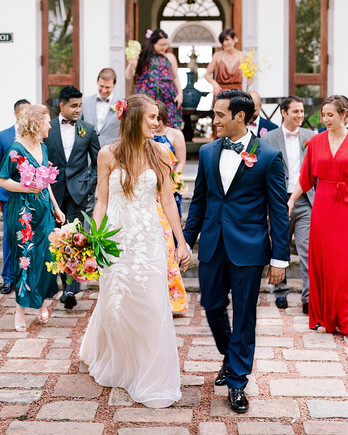 kelly sanjiv wedding couple walking with party