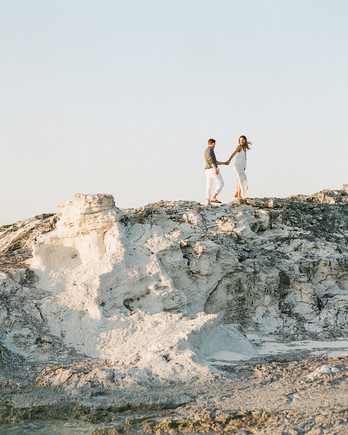 destination engagement couple high rocks on private island