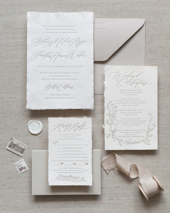 invitation with greenery motifs