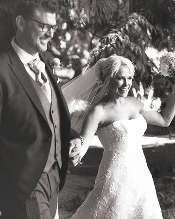 Josie Bissett and husband at wedding