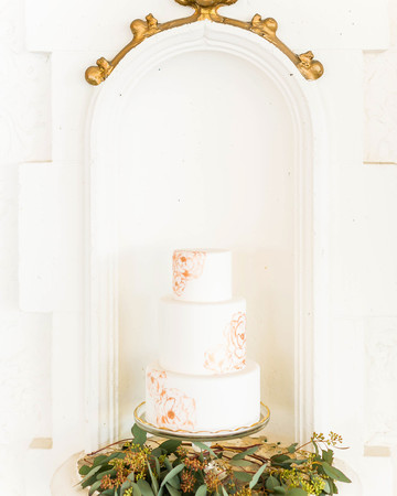 white painted wedding cake