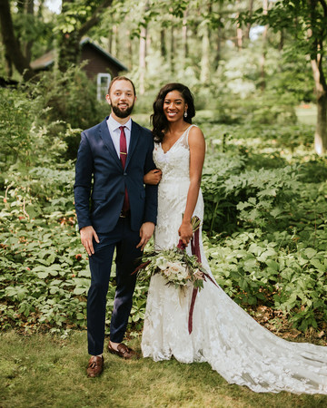 ferbie rob boho wedding couple standing in forest