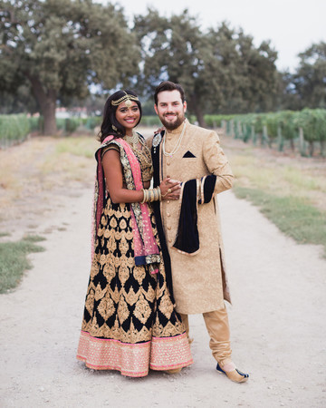 real wedding portrait couple in traditional indian clothing