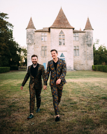 thomas jared wedding couple walking in front of castle