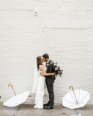 bride and groom first look outside with white umbrellas