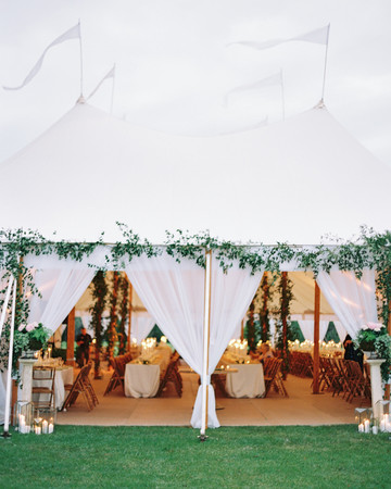 large white candle lit reception tent