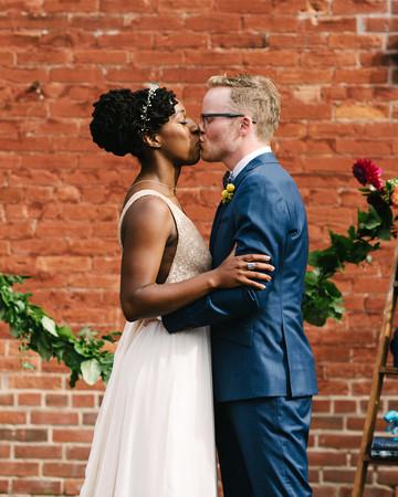 steph tim wedding ceremony couple kiss