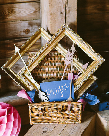 photo booth props basket of gold frames and arrows