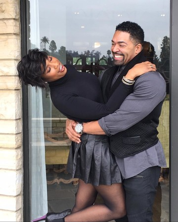 Jennifer Hudson and David Otunga hugging