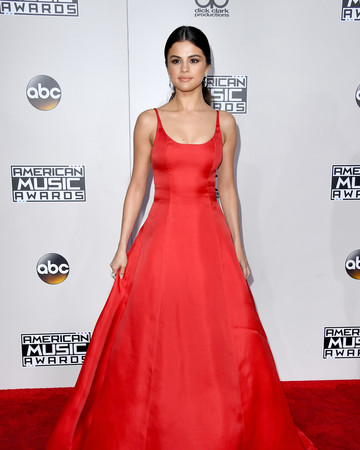 Selena Gomez wearing Prada on the 2016 AMA red carpet