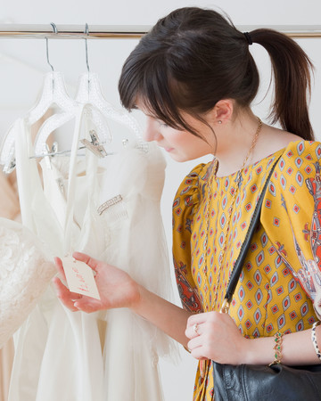 Woman Looking at Wedding Dress Price Tag