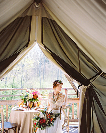 bride in firelight camps tent in new york
