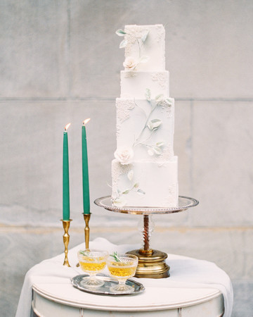 tall four tiered white bas-relief wedding cake