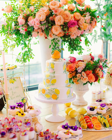 neon cake and flowers on table