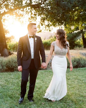 rae rob wedding couple holding hands