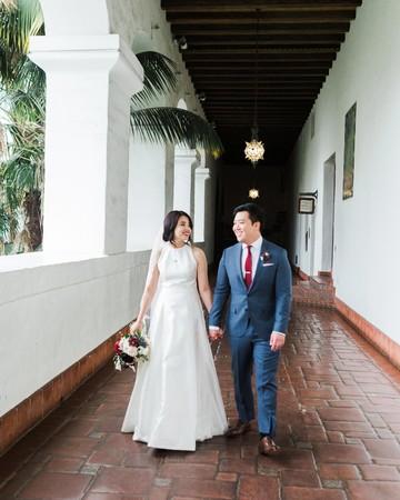 wedding couple walking down hall
