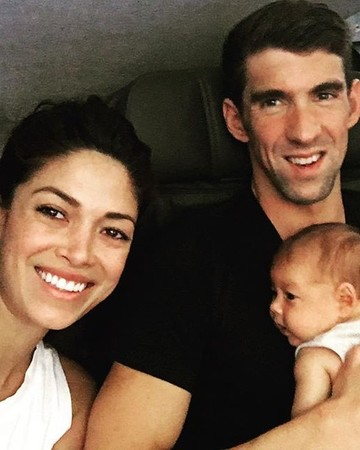 Michael Phelps and Nicole Johnson with their baby, Boomer