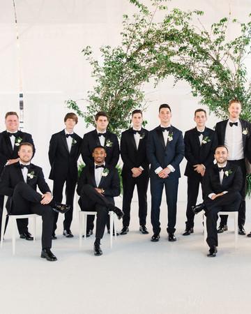 wedding groomsmen group shot with greenery