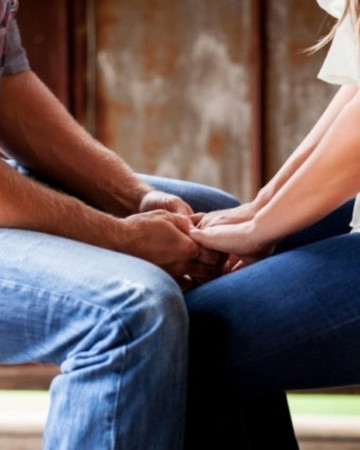 couple holding hands tough experiences