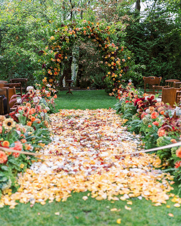 floral and woodland themed ceremony aisle decor