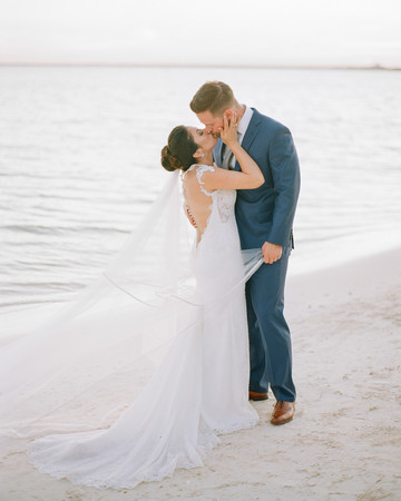 vicky james mexico wedding bride groom beach kiss
