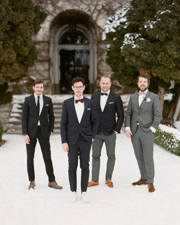 winter wedding guest attire groom and groomsmen in suits