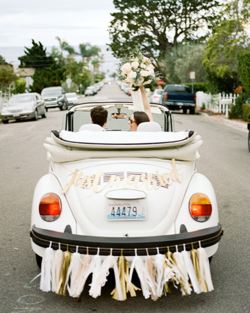 just married couple in car