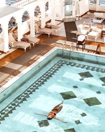 woman swimming pool taj palace