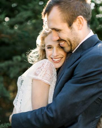 gillian marcus wedding couple smile embrace
