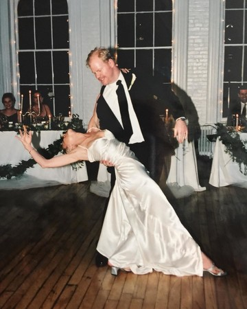 Jim Gaffigan and Jeannie Gaffigan share a dance on their wedding day