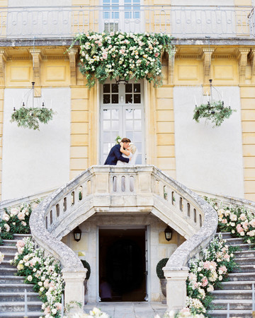rachael cameron wedding couple kiss on staircase