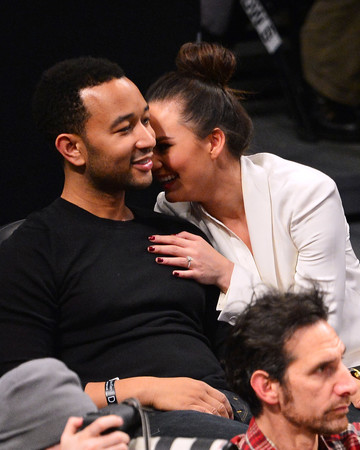 Chrissy Teigen and John Legend at a Basketball Game