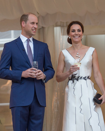 Duchess Kate in a white Gosia Baczynska dress with Prince William