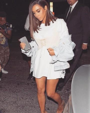 Kim Kardashian in a t-shirt and corset