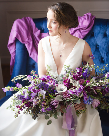 purple bouquet with garden roses anemones hyacinth