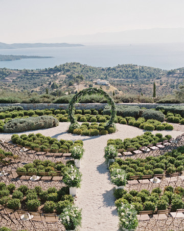 sze amanzoe wedding ceremony arch greece elegant