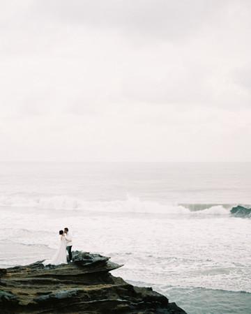 vivi yoga bali wedding ceremony couple ocean rocks