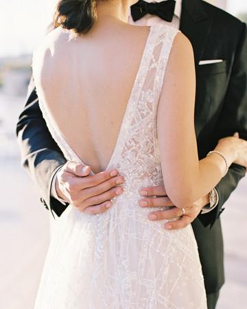 sze amanzoe wedding couple embrace greece elegant