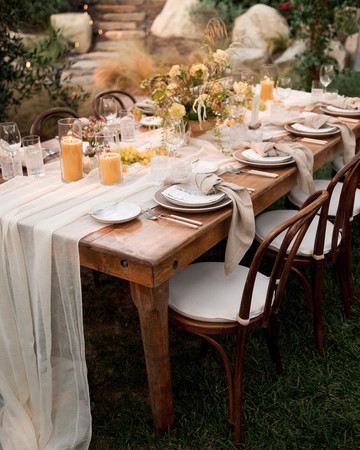 anika max wedding small reception table with linens flowers and table settings