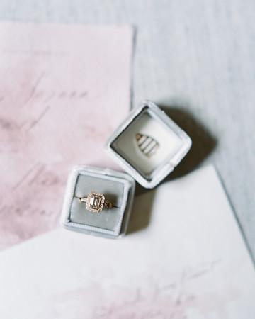 emerald cut wedding ring in a gray box