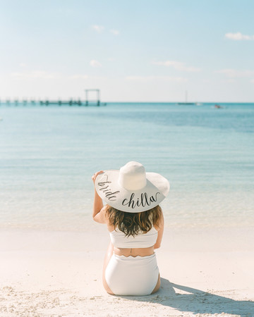 woman wearing bride chilla straw hat on beach