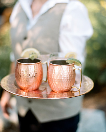 kaitlin jeremy rehearsal dinner whiskey mules on tray