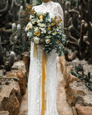 yellow, white, and green bouquet with ribbons