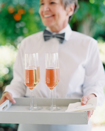 A Woman Holding Glasses of Champagne