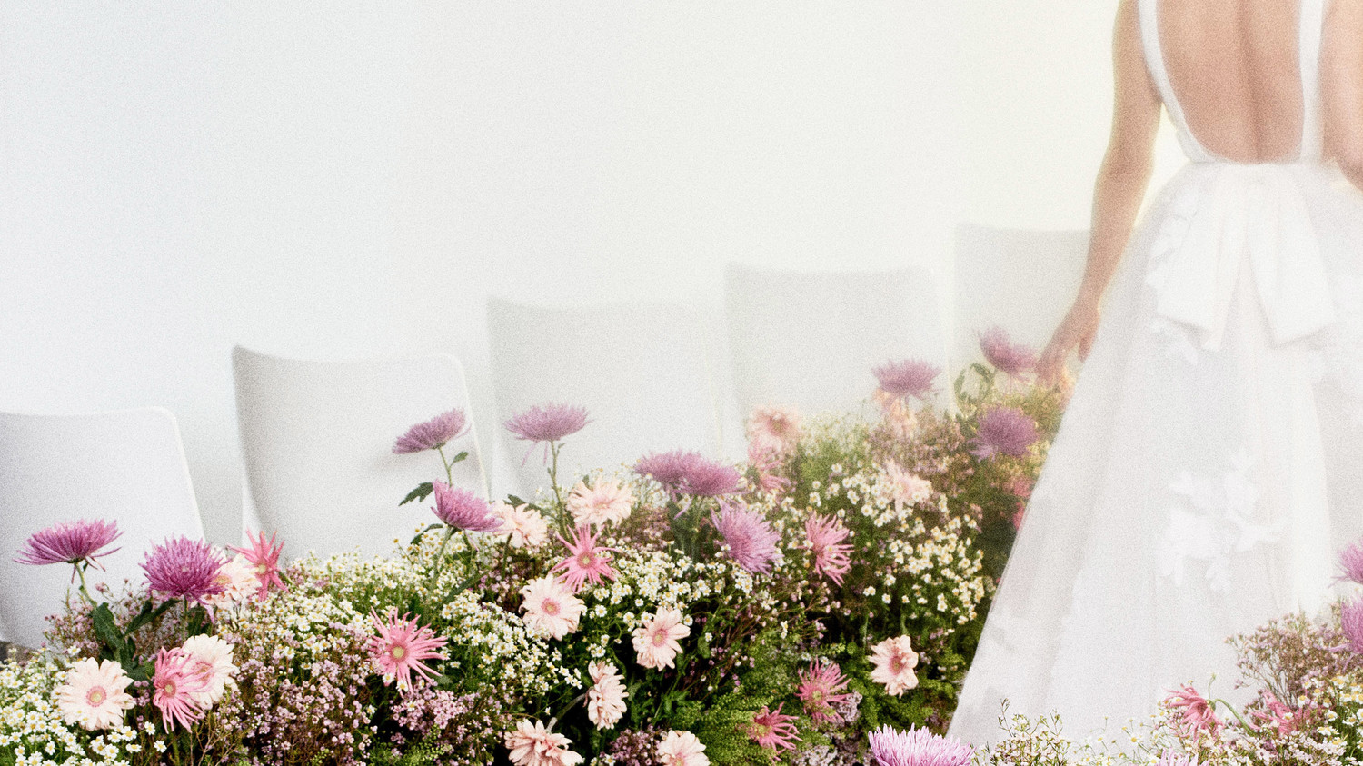 aisle flowers with white wedding dress