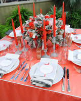 Red Candles Around Floral Winter Centerpiece